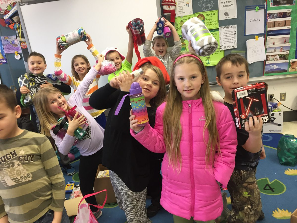 Students pose with donated items