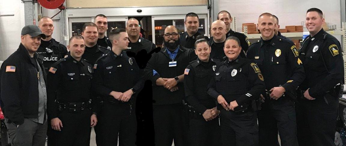 Police officers pose for a photo inside a store