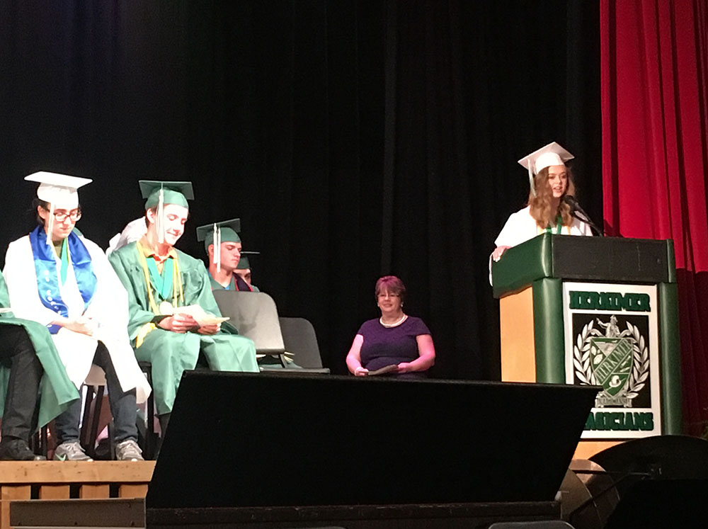 Valedictorian Jenna Vincent speaks at a podium