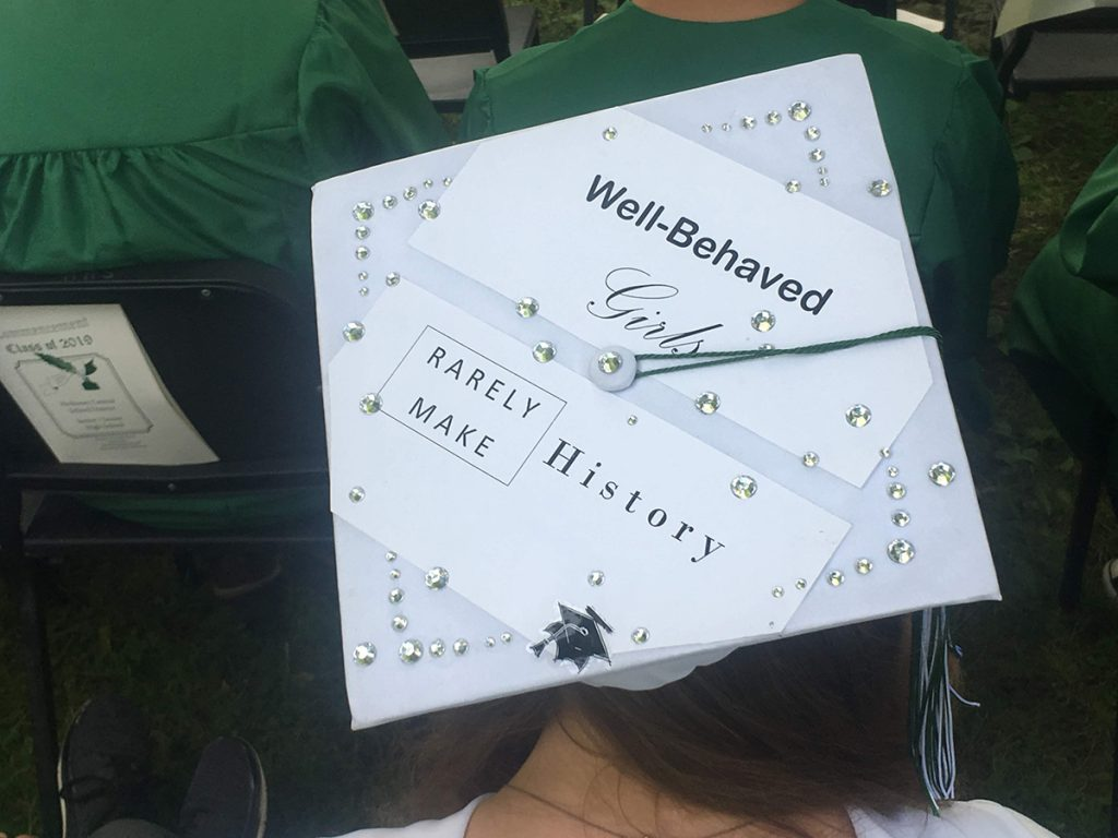 """A student's mortarboard reads, """"Well-behaved girls rarely make history"""""""