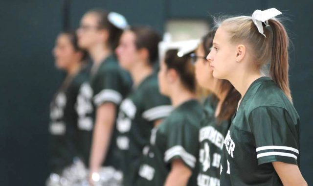 Cheerleaders stand in a line
