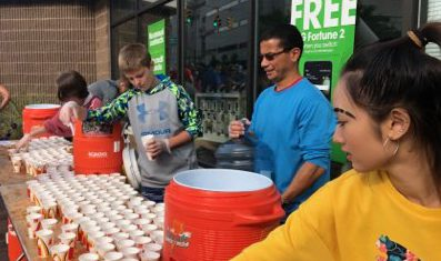 Students hand out cups of water
