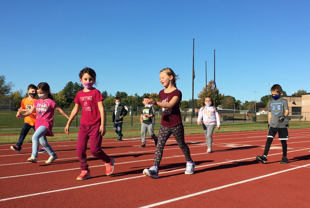 Students walk along a track