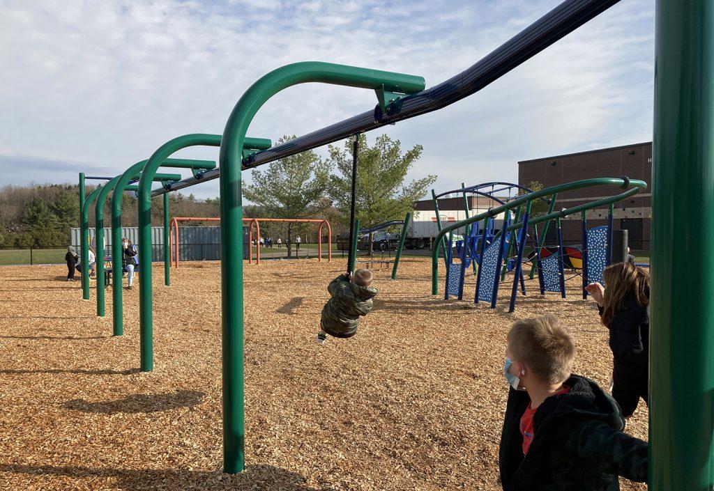 Student swings on a zip line