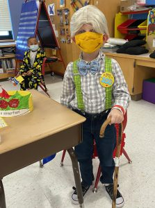 A student dresses up for the 100th day of school