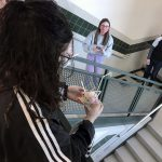 Students drop an egg from the stairs during a project.