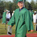 A graduate smiles for the camera